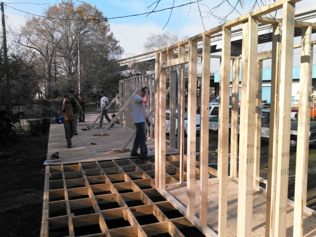 a peak at our progress showing our framed walls and the blocked and braced area that will be the dogtrot porch.