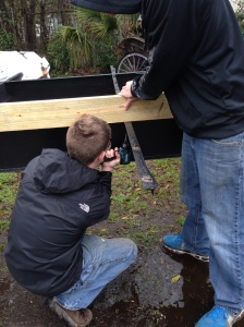 Nicholas Caro putting the first screw into the project.